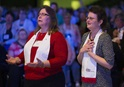 United Methodist Deaconesses Becky Louter (right) and Judy Poole sing during closing worship at the United Methodist Women's Assembly in 2014. Photo by Mike DuBose, UMNS.