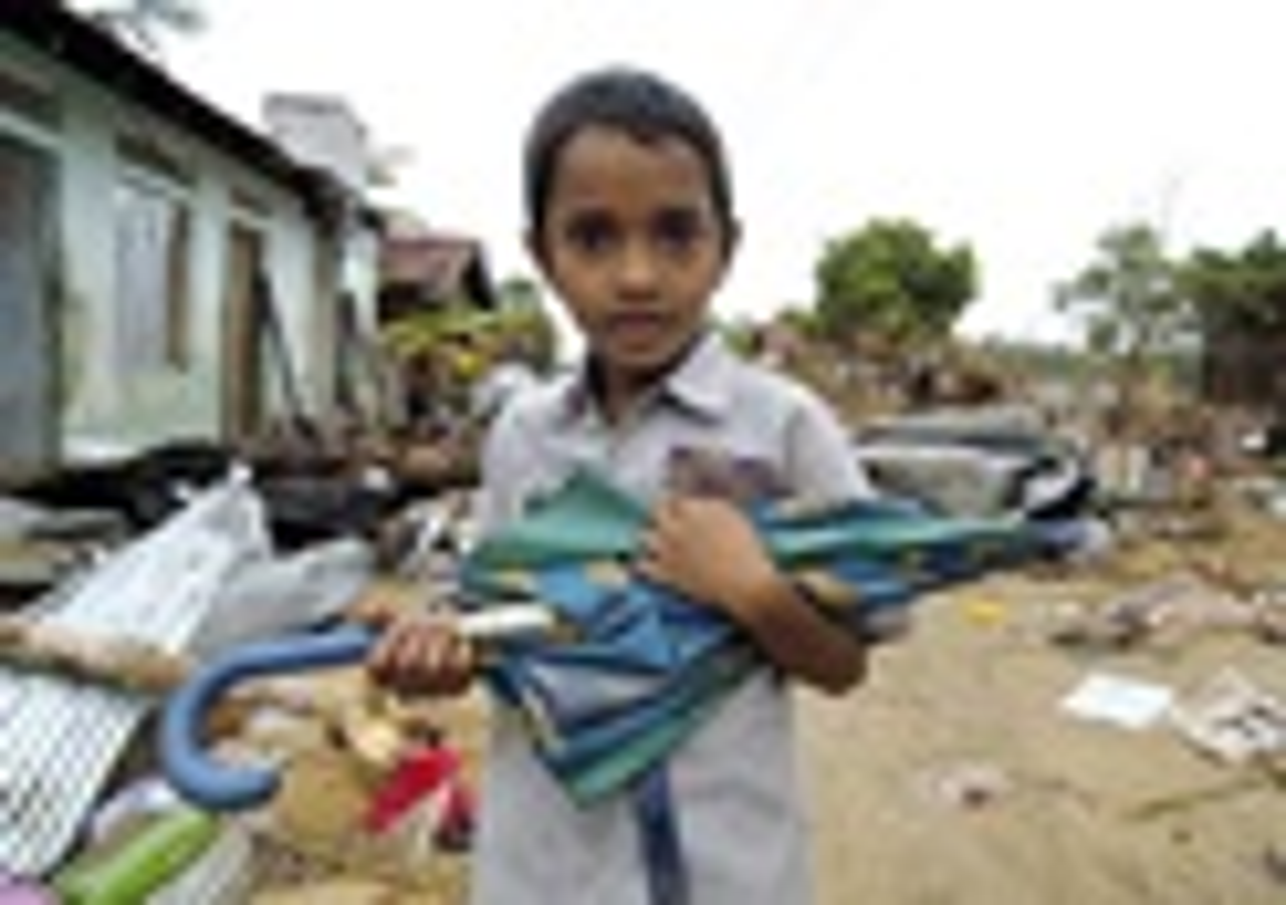 A young tsunami survivor poses in Batticaloa, Sri Lanka. A UMNS photo by Paul Jeffrey, ACT International.