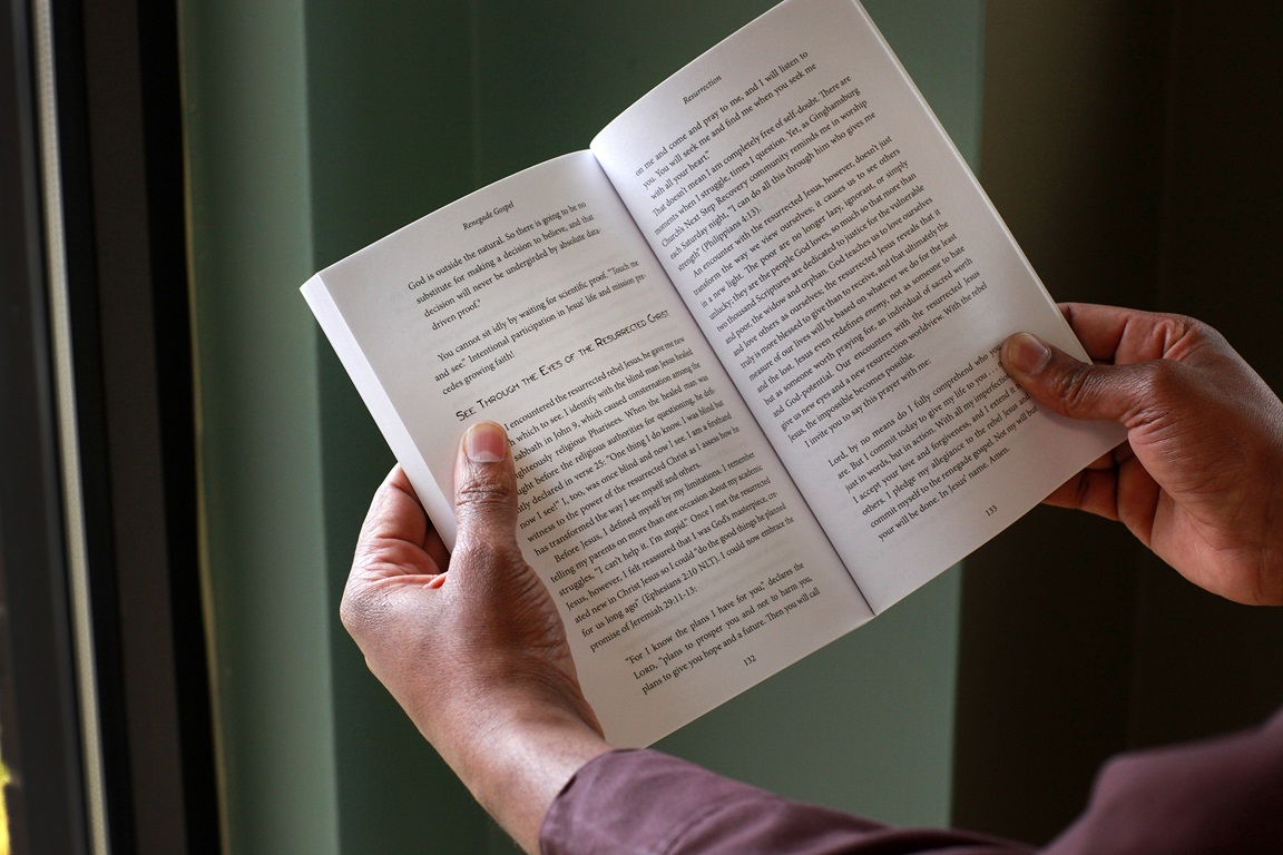 A man reads from Lenten study guide. Photo illustration by Kathleen Barry, United Methodist Communications.