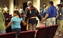 Attendees of the Native American Summer Conference form a circle in prayer. Photo by Kathleen Barry, United Methodist Communications