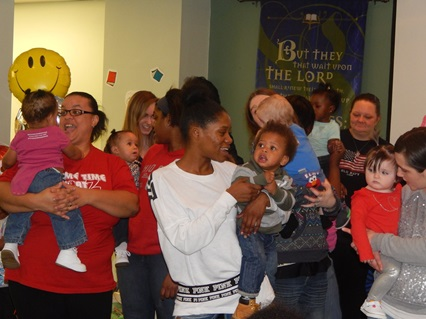 Parents and children gather to celebrate the first birthdays of Southside children in Columbus, Ohio, served by CD4AP. Photo courtesy of Greg Hennemen.