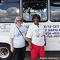Cecelia Whitfield (r), founder of Use What You've Got Prison Ministry, stands with Leah Richmond-Jones beside the ministry's bus. Image courtesy of United Methodist Women.
