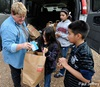 Debbie Humphrey, a United Methodist deaconess, delivers bags of supplementary food to poor children in an isolated community in Oklahoma. Photo by Paul Jeffrey, United Methodist Women.