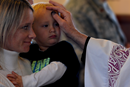 A child receives ashes on the forehead during an Ash Wednesday service at the Friendship Chapel at Shaw Air Force Base, S.C., Feb. 10, 2016. Ashes are applied to people's foreheads to symbolize the dust from which God made humans. (U.S. Air Force photo by Senior Airman Michael Cossaboom).