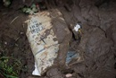 Photo by Mike DuBose, UMNS  A Bible coated in mud lays outside Fenwick (W. Va.) United Methodist Church following heavy flooding. Photo by Mike DuBose, UMNS