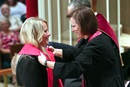 Tiffany Nagel Monroe (left) receives the stole of an elder from the Rev. Linda Harker during a service of ordination June 1, 2016, at St. Luke's United Methodist Church, in Oklahoma City. Photo by Hugh W. Scott, Oklahoma Conference.