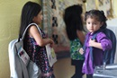 Cecilia Salamanca, left, and a young friend carry school backpacks. Photo by Kathleen Barry, UMNS