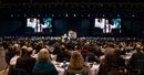 Delegates attend opening worship at the 2019 United Methodist General Conference in St. Louis in February. Given escalating conflict in the denomination over LGBTQ inclusion, two bishops are pushing a plan to create two or three self-governing church groups, with The United Methodist Church remaining as an umbrella organization. File photo by Kathleen Barry, UM News.