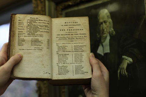 Archivist-Records Administrator, Frances Lyons-Bristol, holds a book of listing early Methodists including circuit rider the Rev. Freeborn Garrettson, one of thousands of historic items and documents housed at the General Commission on Archives and History at Drew University in Madison, New Jersey. Journals courtesy of the General Commission on Archives and History of the United Methodist Church. Photo by Kathleen Barry, UMNS.
