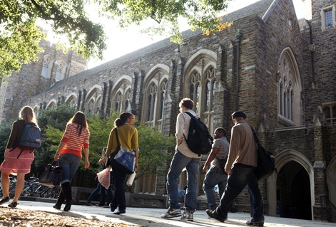 Students walk on the academic quad with Perkins Library in background on the campus of Duke University. Photo by Les Todd, Duke University.