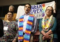 """The Rev. Will Green (center) leads the singing of """"Jesus Remember Me When You Come Into Your Kingdom"""" at the """"Queer Prayer Station"""" during the Feb. 23 morning of prayer at the 2019 Special Session of the United Methodist General Conference in St. Louis. Green serves one of nine New England churches looking into leaving the denomination. Photo by Kathleen Barry, UMNS."""