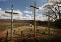 Three crosses stand above the cemetery at Israel United Methodist Church near Montrose, W.Va. Photo by Mike DuBose, UM News.